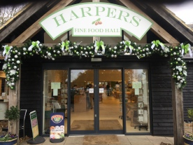 Green and silver garland at entrance to Harpers Fine Foods