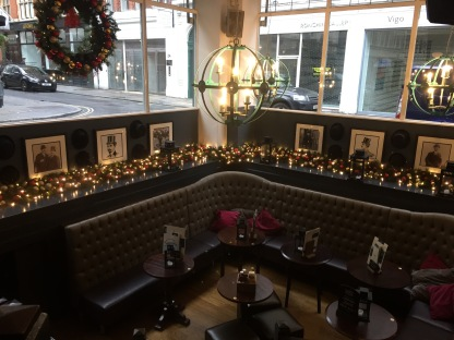 Decorated garland around seating area in Bonds London