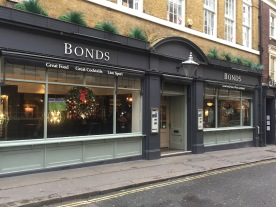 Red and gold decorated wreaths at Bonds London