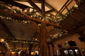 Ceiling decoration on wooden beams at the Oast House