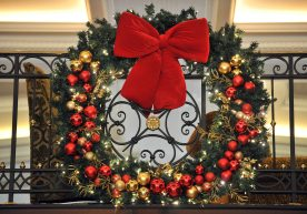 Large festive wreath decorated with red and gold baubles in a hotel